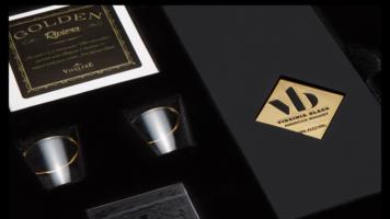 Cocktail Kingdom gold-rimmed shot glasses