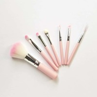 Set of 7 small, pink travel brushes