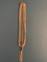 Multi-Strand Tassel Necklace With Charm