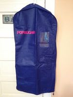 The Green Garmento multi-use 4-in-1 bag in blue with POPSUGAR's logo in pink
