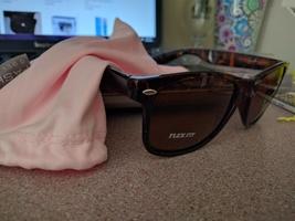 Tortoise shell sunglasses and bag