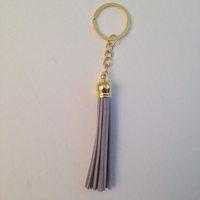 Boho Faux Suede Brass Tassel Fringe Charm Keychain by Pink Lemonade