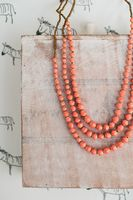 31 Bits Armadillo Song Necklace in Coral