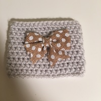 Knitted drink cozy with bow