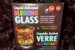 Liquid activated blinking glass