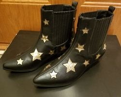 Y.R.U. black ankle boots with gold stars
