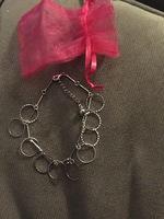 Silver tone Going Through Hoops bracelet