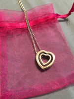 Double heart necklace with rhinestones on the outter heart