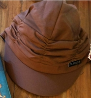 Brown newsboy cap