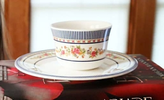 Plastic cup and saucer
