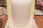 White candle plate and pillar candle