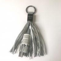 Hurry Up Charging Tassel Keychain