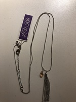Long delicate necklace with crystal pendant and tassel