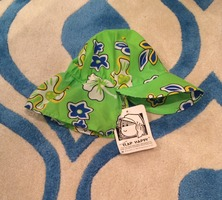 the Original Flap Happy hat (green design)