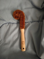 Coconut and wood scrubber