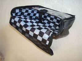 Black Cosmetics Case with Checkered Interior and Purple Strap