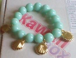 sea foam green and gold shell bracelet