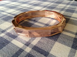 Rose colored hinged bangle