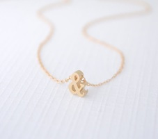 Gold ampersand necklace