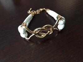 Bravado gold and white bracelet