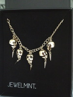 Jewelmint Golden Skulls Necklace