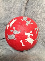 Crocodile Creek rubber ball red with dogs & bones