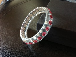 Clear lucite bangle bracelet with pink rhinestones