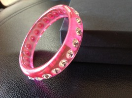 Pink lucite bangle bracelet with clear rhinestones